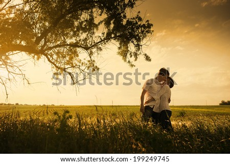 Happy couple outdoor, summertime, tinted photo - stock photo