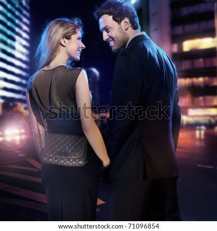 Happy couple over city scenery - stock photo
