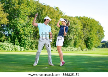 Happy couple playing golf