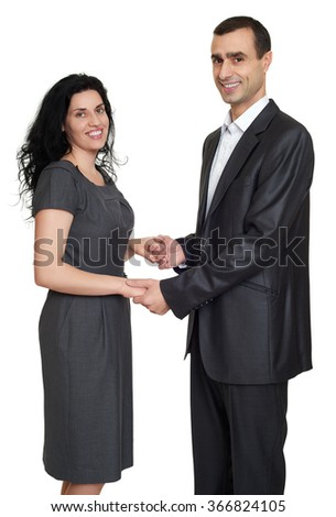 Happy couple portrait at studio dressed in classic clothes