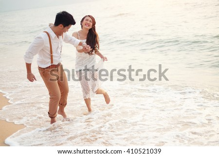 Happy couple relaxing and smile on the beach - stock photo