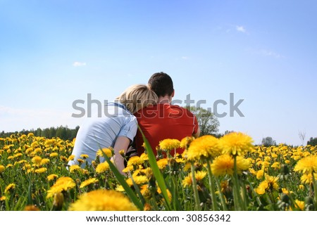 happy couple relaxing outdoors - stock photo