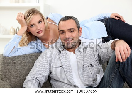 happy couple resting at home - stock photo