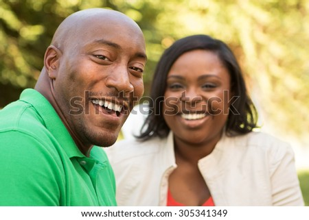 Happy couple. Selective focus on the African American man. - stock photo