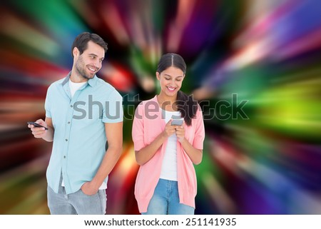 Happy couple sending text messages against blurred lights