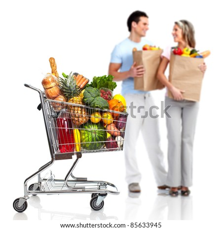 Happy couple shopping in supermarket grocery . Isolated over white background.
