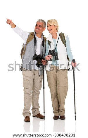 happy couple sightseeing and pointing direction - stock photo