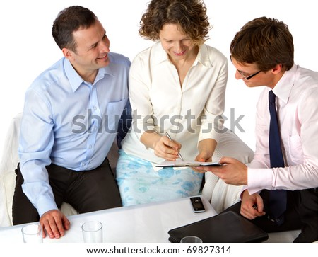Happy couple signing of the agreement. - stock photo