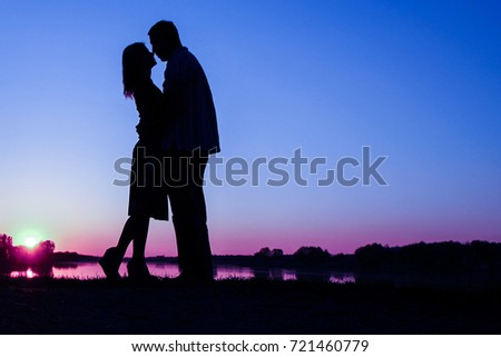 happy couple silhouette against a sunset romance