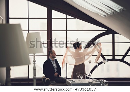 happy couple sitting in a restaurant