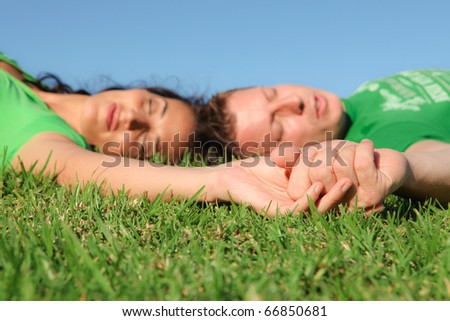 happy couple sleeping outdoors in summer - stock photo