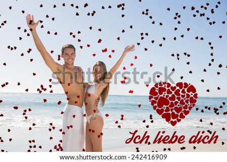 Happy couple smiling at camera and waving against ich liebe dich - stock photo