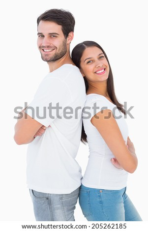 Happy couple smiling at camera on white background - stock photo