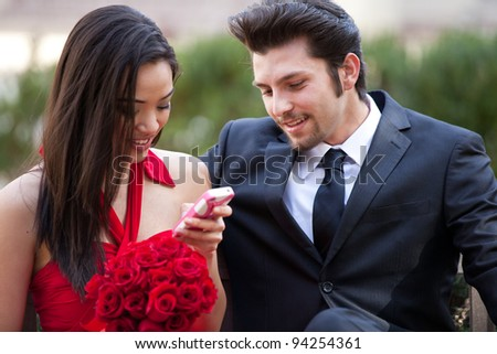 Happy couple smiling enjoying a romantic moment Valentines Day or Wedding - stock photo