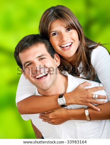 happy couple smiling outdoors - stock photo