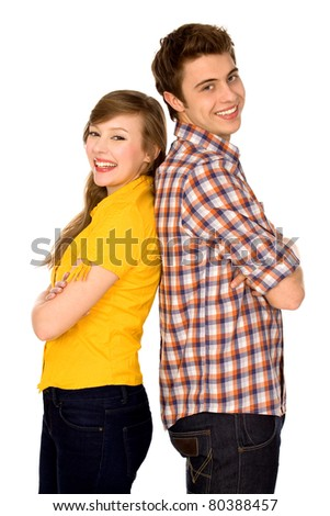 Happy couple standing back to back - stock photo