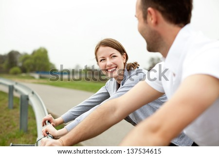 Happy couple stretching before running - stock photo