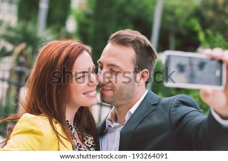 Happy couple taking selfie - stock photo