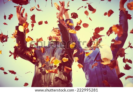 Happy  couple throwing  autumn fall leaves - stock photo