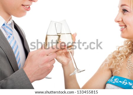 Happy couple toasting with glass of wine, isolated on white background - stock photo