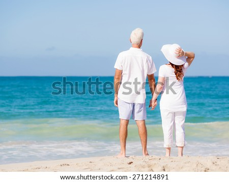 Happy couple together on the beach - stock photo