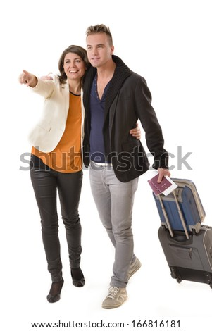 Happy couple traveling, pointing somewhere - stock photo
