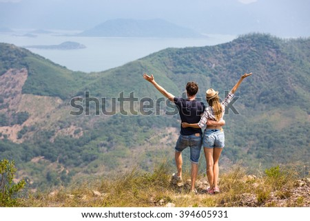 Happy couple traveling together, hiking in the mountains in Asia - stock photo