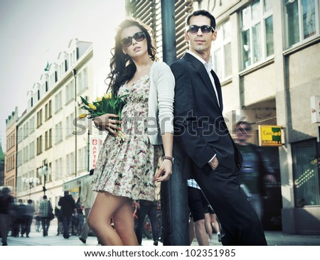 Happy couple wearing sunglasses - stock photo