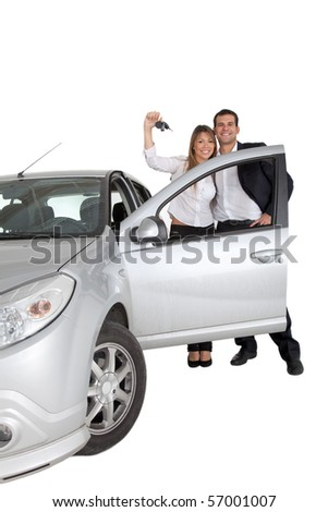 Happy couple with a car isolated over a white background - stock photo