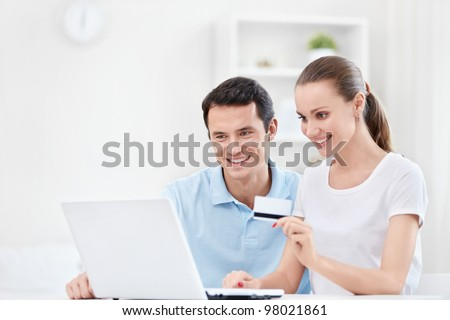 Happy couple with a credit card