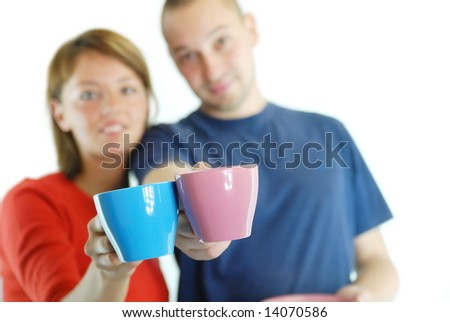 happy couple with coffee cups - stock photo