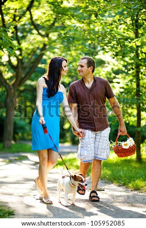 happy couple with dog - stock photo