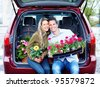 Happy couple with flowers. Gardening. - stock photo