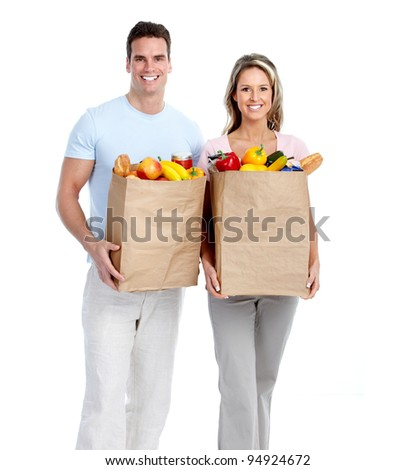 Happy couple with grocery bag. Isolated on white background. - stock photo
