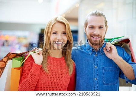 Happy couple with purchases - stock photo