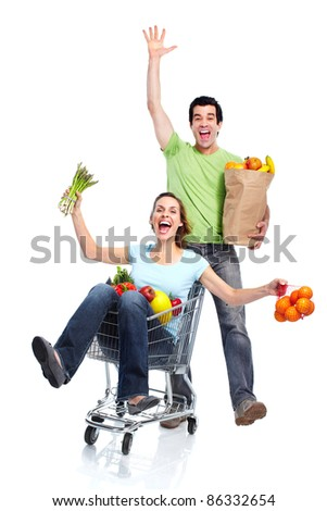 Happy couple with shopping cart. Isolated over white background.