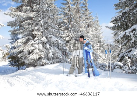 Happy couple with ski in the winter landscape