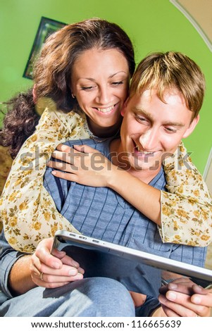 happy couple with tablet pc - stock photo