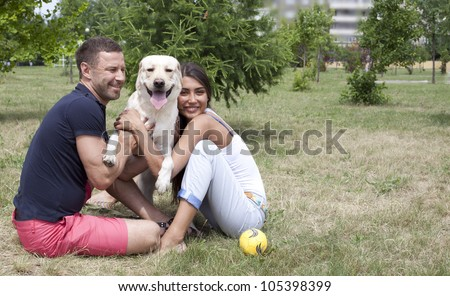 Happy Couple With Their labrador