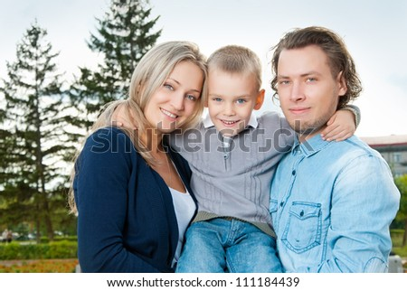 Happy couple with their son
