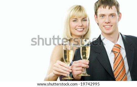 Happy couple with tumblers with champagne