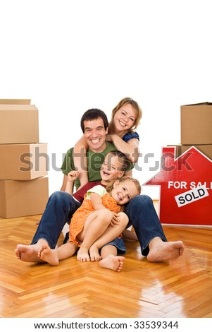 Happy couple with two kids having fun on the floor in their newly bought home - isolated