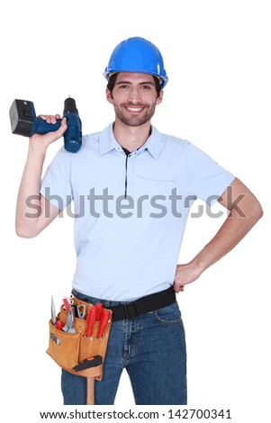 happy craftsman holding a drill - stock photo