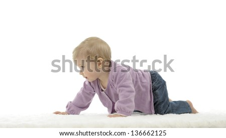 happy crawling baby with colored cubes, isolated on white background
