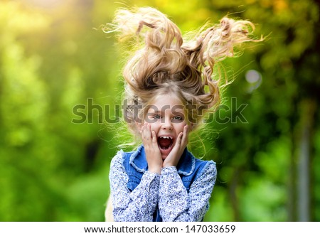 Happy crazy kid with long hair - stock photo