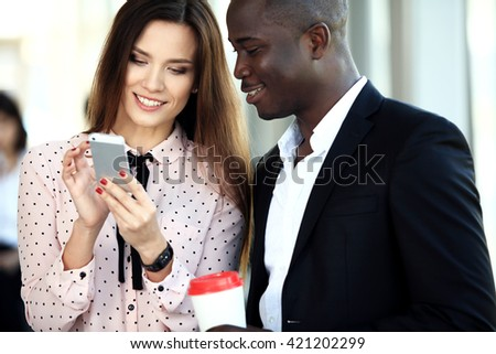 Happy creative young business people in meeting - stock photo