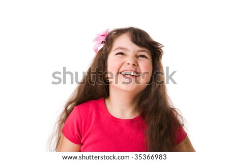 Happy curious little girl looking up isolated on white