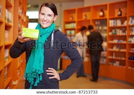 Happy customer recommending product in a pharmacy - stock photo