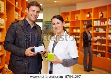 Happy customer with a pharmacist in a pharmacy