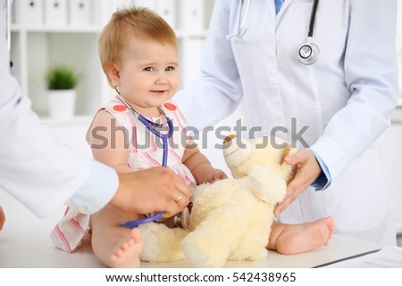 Happy cute baby  after health exam at doctor's office. Medicine and health care concept